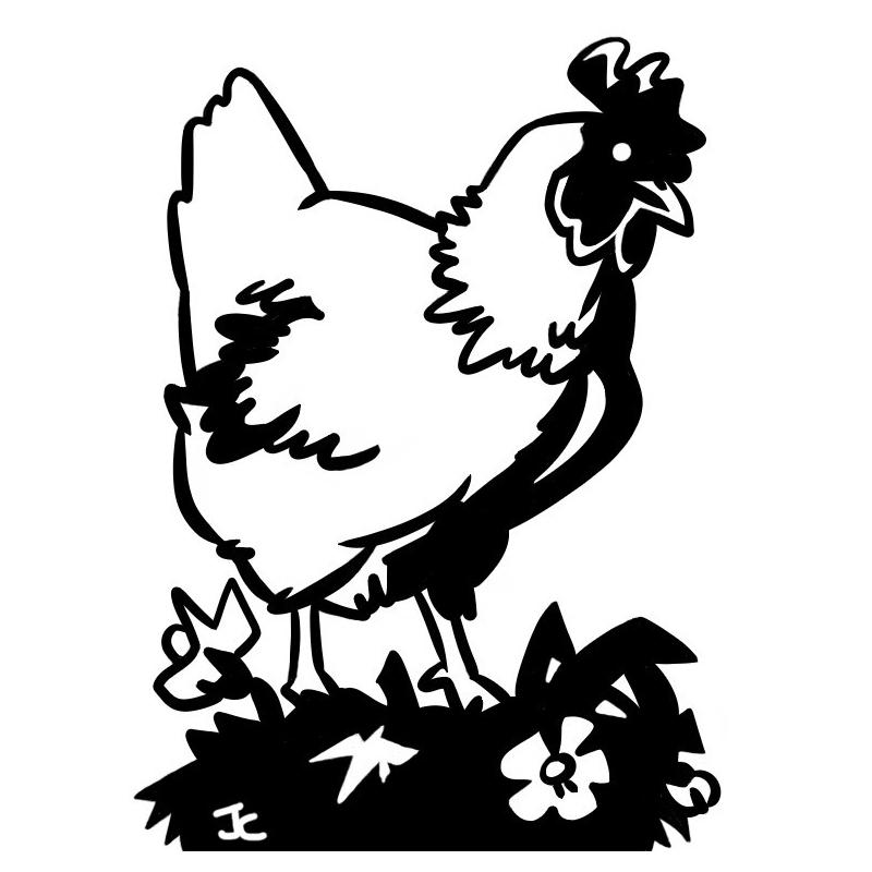 Poule sur herbe